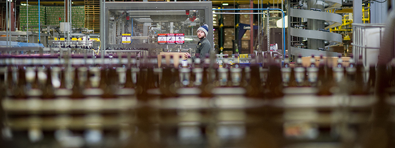 An employee works on the bottling line on Tuesday, Jan. 12, 2016, at SweetWater Brewing Company in Atlanta, Ga. (AJ Reynolds for The Brewer Magazine)