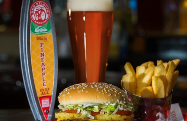 Red Robin Gourmet Burgers and Brews partners with New Belgium Brewing to create Grilled Pineapple Golden Ale, the first-ever special release beer inspired the unique components of Red Robin's famous Banzai Burger. The beer will make its debut at the Great American Beer Festival on Oct. 6-8, in Denver, and will be served on-tap at Red Robin Gourmet Burgers and Brews restaurant throughout Colorado while supplies last. (PRNewsFoto/Red Robin Gourmet Burgers, Inc.)